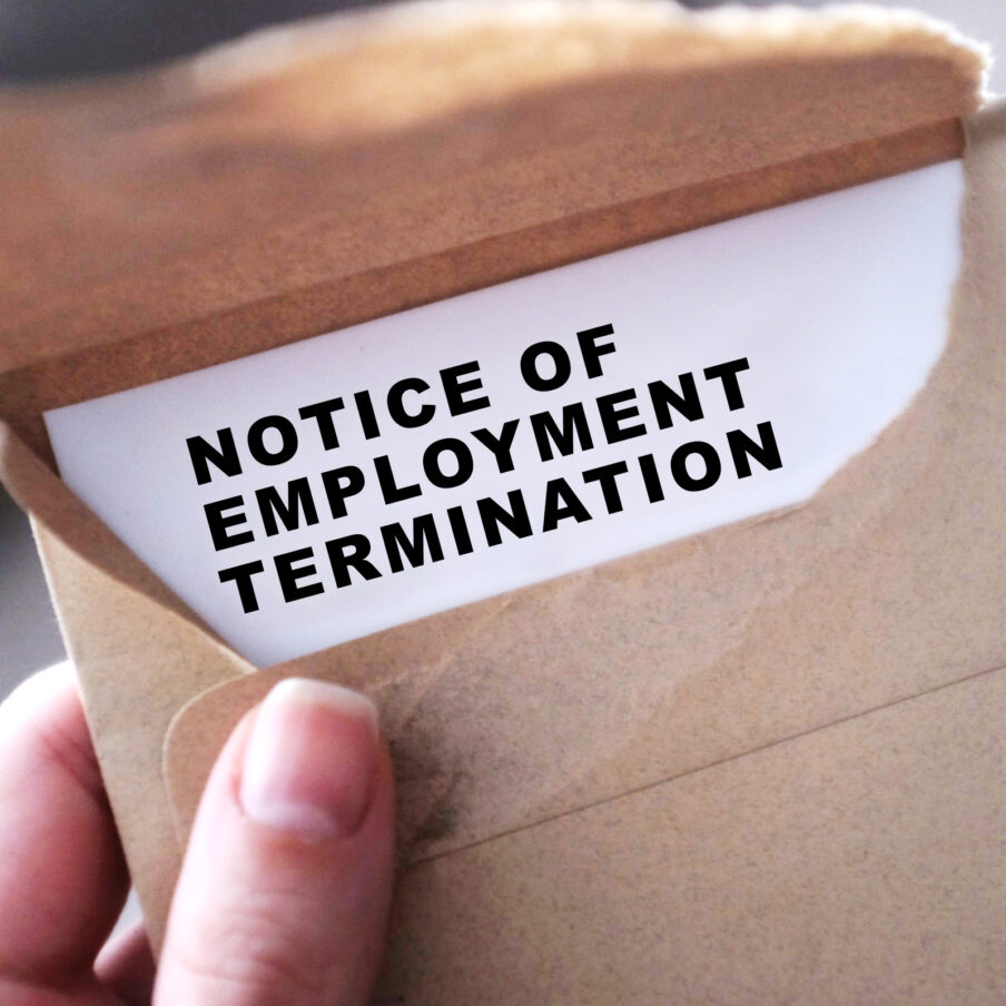 An employee opens a notice of employment termination