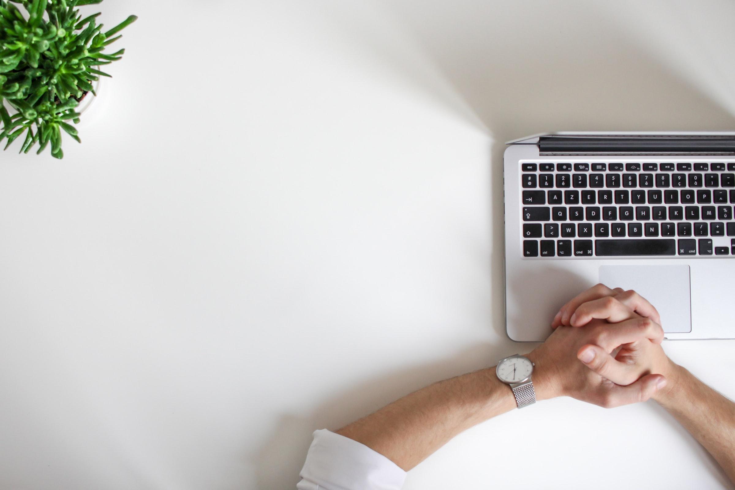 hr burnout - hands folded at a desk